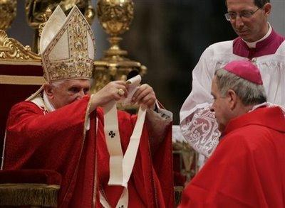The Pontiff imposes the pallium on a new Archbishop.